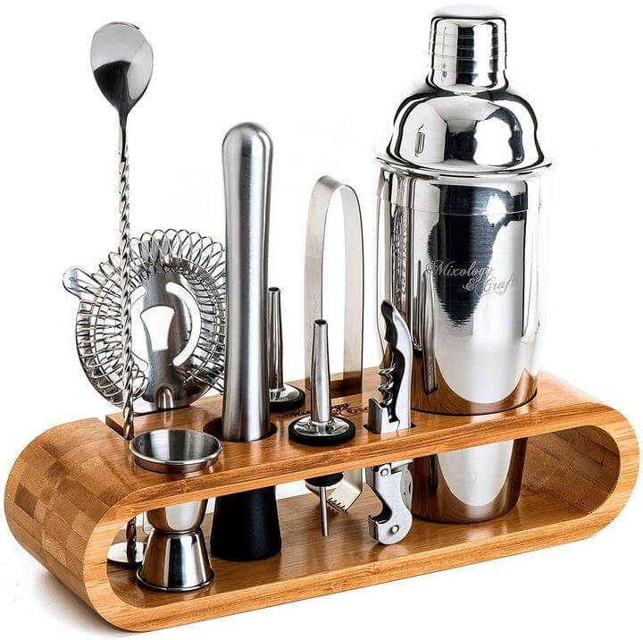 Mixology and craft home bar barware set with bamboo stand.