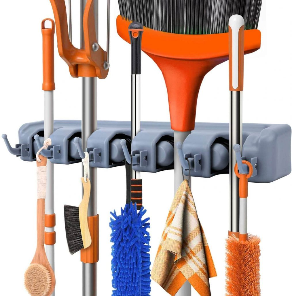 Wall-mounted mop or broom holder by Feir.