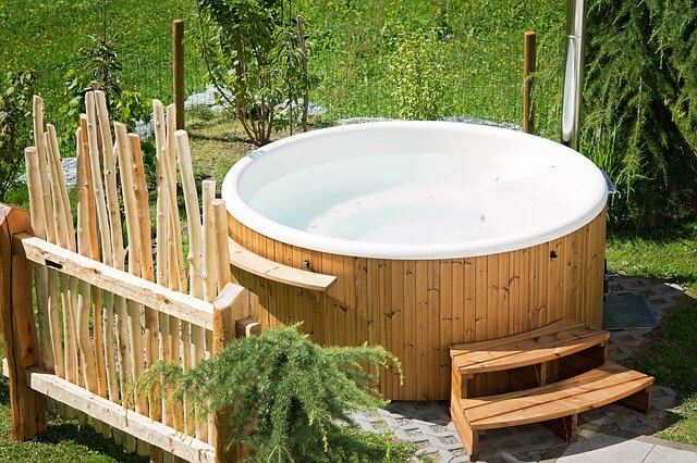 How close should a hot tub be to the house?