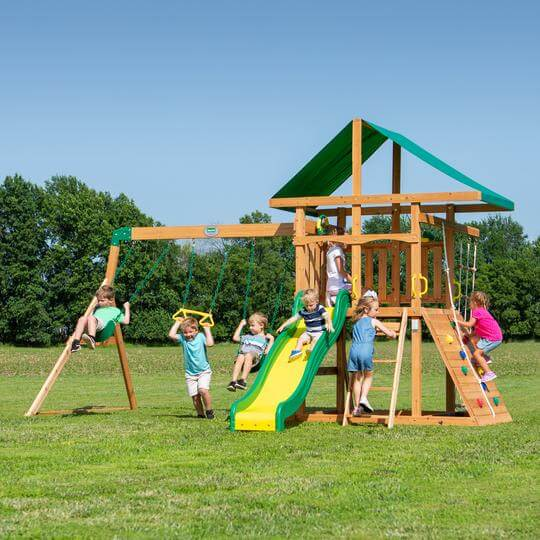 Cedar wood outdoor playset with swings by Backyard Discovery.