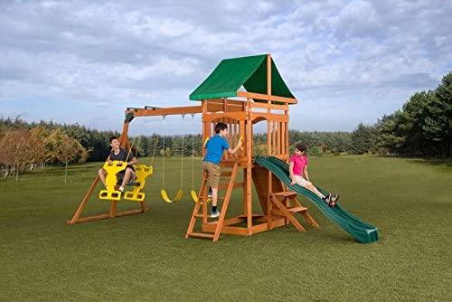 Cedar wood outdoor playset with swings and slide.