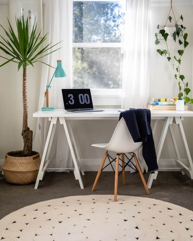 How can you maximize space in a small home office?