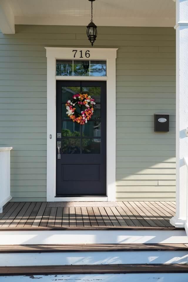 How high should a wreath hang on a door?