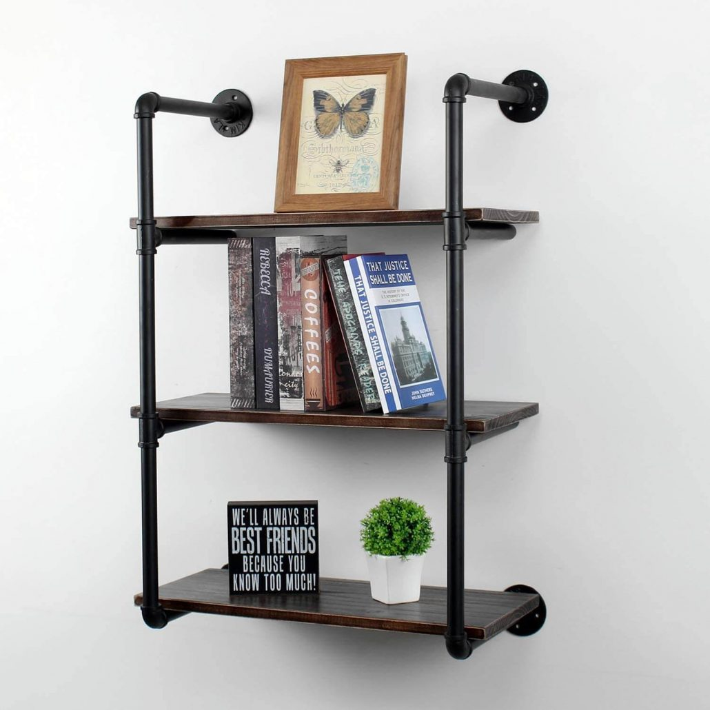 Modern rustic floating shelf bookcase made from reclaimed wood and pipe.