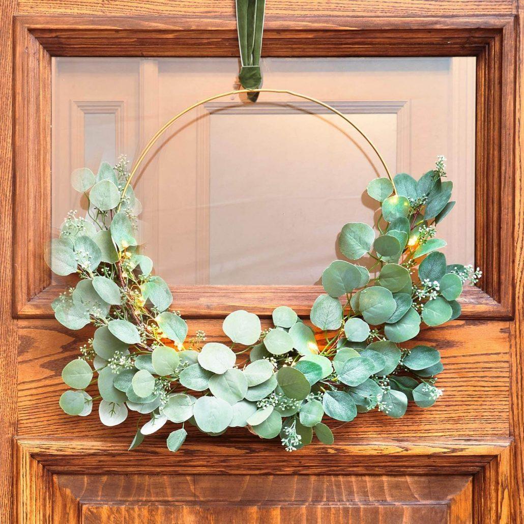 Eucalyptus spring wreath with LED lights and velvet ribbon.