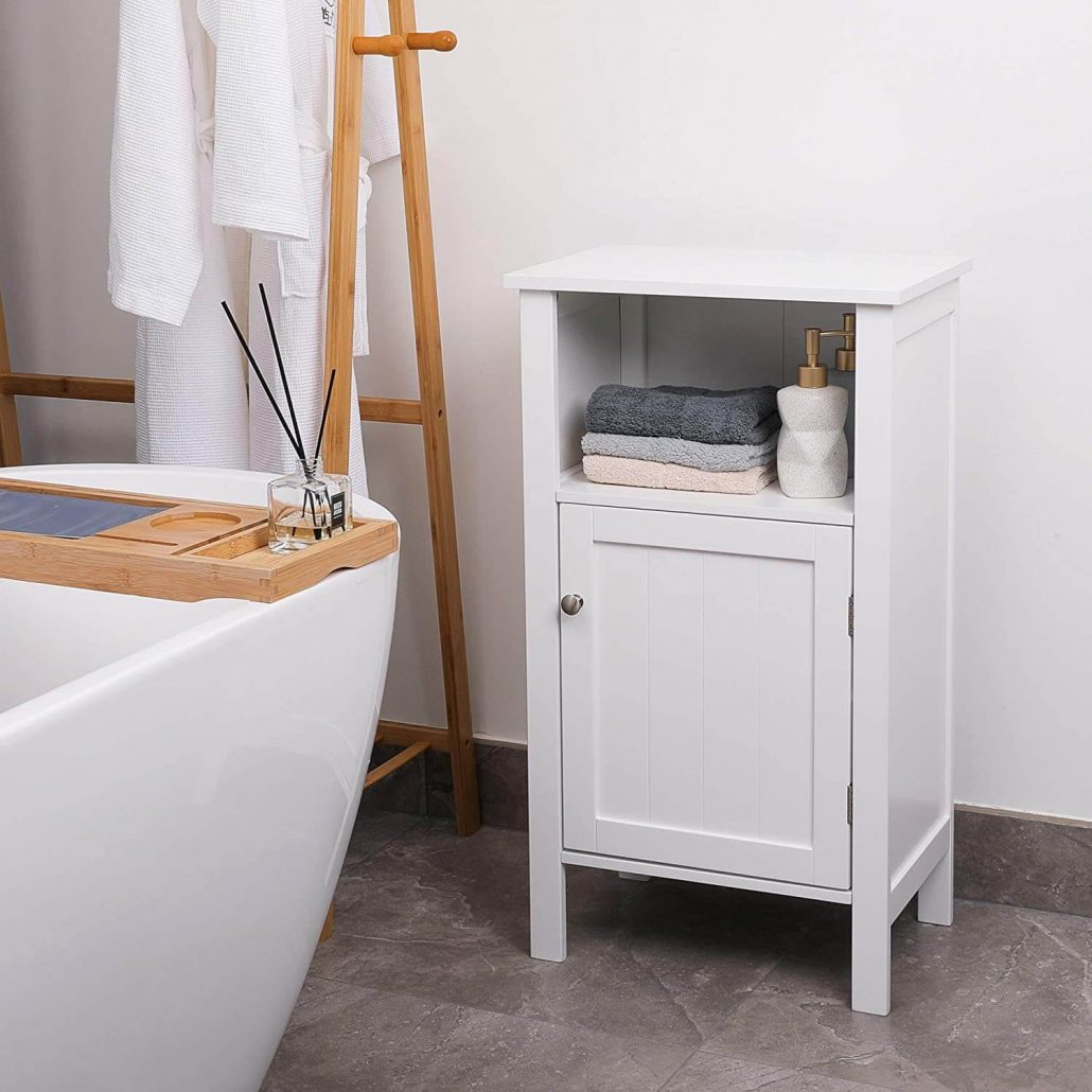 Small standalone white bathroom storage cabinet.