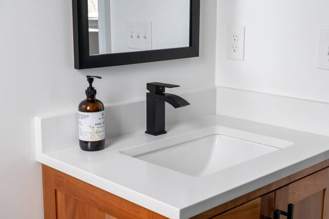 What should be stored under the bathroom sink?