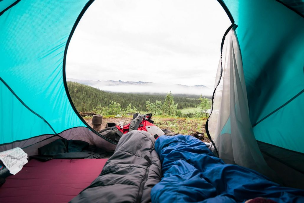 How can you make your camping mattress more comfortable?